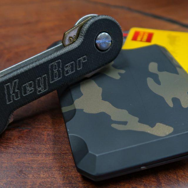 Black Canvas Micarta KeyBar Key Organizer EDC Tool and OG Camo Cerakoted Aluminum Hell-bent Combat Wallet Bundle Lifestyle Image