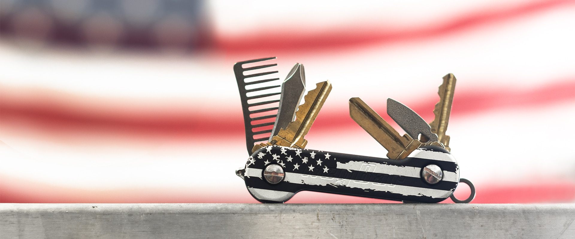 Black Distressed KeyBar in front of American Flag 1920x800