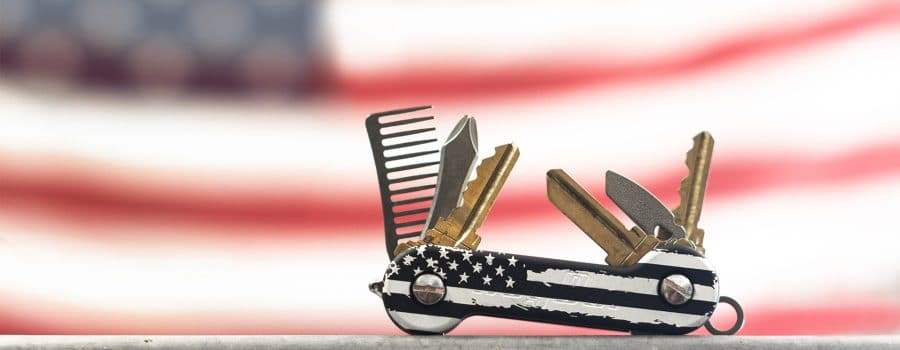 Black Distressed KeyBar in front of American Flag cropped 1920x800
