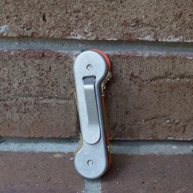 Aluminum-Clip-Side-with-Orange-G10-Front-Lifestyle-Image